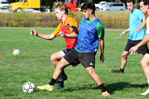 A pair of Lewis and Clark players battle for the ball during a drill Thursday at Tim Rooney Stadium. Thursday was the first day of fall offseason practice for sports at LCCC.