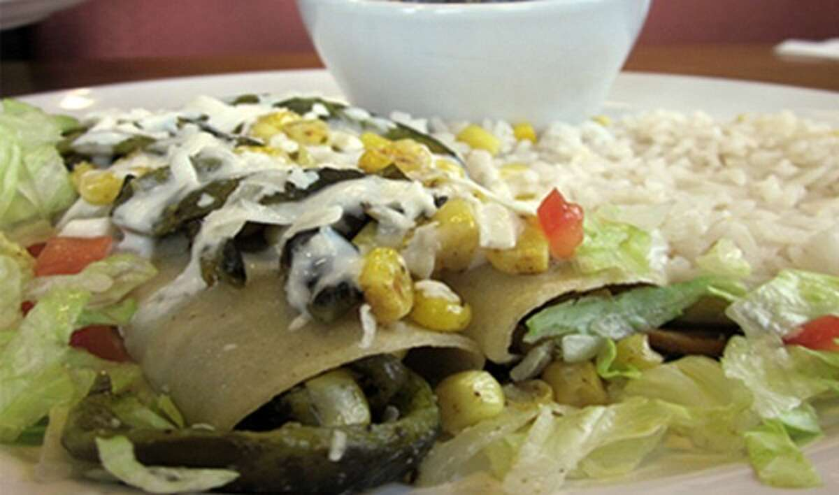 Ay Chiwawa's award-winning menu includes staples, like enchiladas verdes, huevos rancheros and burritos, as well as specialties like steak tampiqueno. The bar offers drinks, like mango chamoy margaritas to wash it all down.