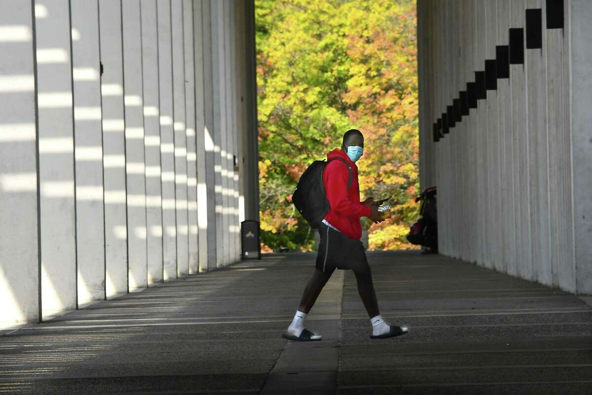 A student is seen walking near the campus center of University at Albany on Friday, Sept. 25, 2020 in Albany, N.Y. (Lori Van Buren/Times Union)