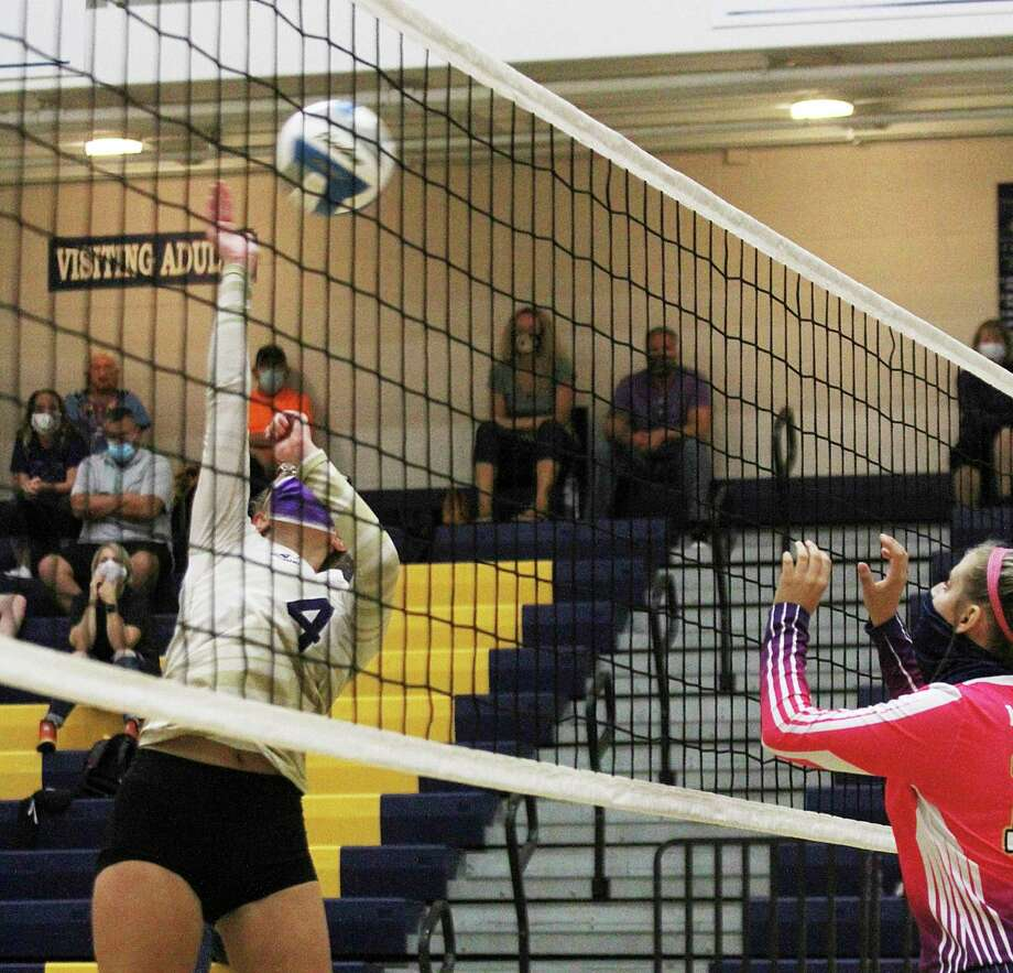 Sydney Miller goes up for a kill at the net. (Photo/Dylan Savela)