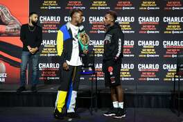 Jermall Charlo (left) and twin brother Jermell Charlo chat after a press conference promoting their upcoming pay-per-view on Saturday, Sept. 26, 2020.