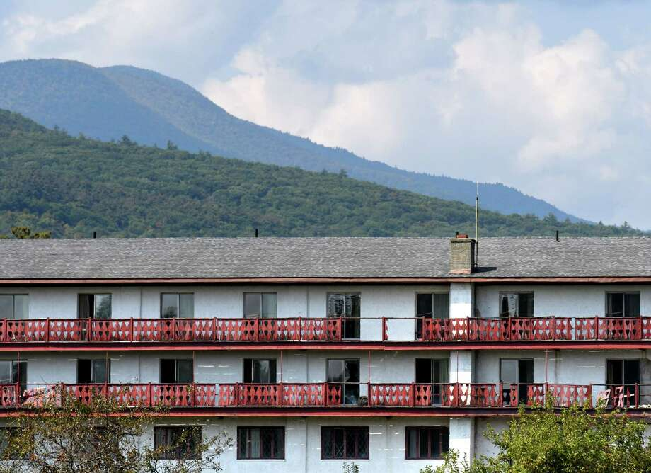 A Catskill mountain backdrop is seen behind the old Friar Tuck resort on Friday, Sept. 25, 2020, in Catskill, N.Y. Chinese investors have big plans for the long-dormant Catskill  Friar resort including water park, skating rink and retail village. Resort is over 200 acres in Catskill but needs major renovation. (Will Waldron/Times Union) Photo: Will Waldron, Albany Times Union / 40049995A