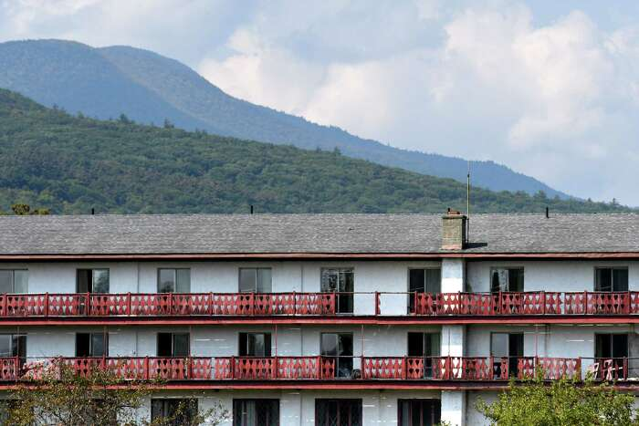 A Catskill mountain backdrop is seen behind the old Friar Tuck resort on Friday, Sept. 25, 2020, in Catskill, N.Y. Chinese investors have big plans for the long-dormant Catskill Friar resort including water park, skating rink and retail village. Resort is over 200 acres in Catskill but needs major renovation. (Will Waldron/Times Union)
