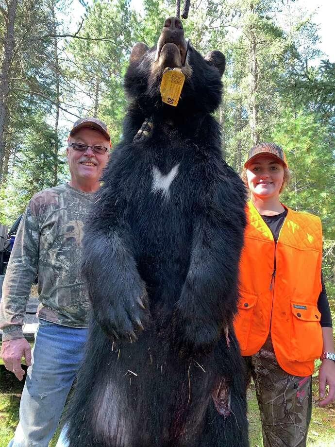 Natalie Chapman (right) of Big Rapids shows her bear along with Kip Cameron of Kip Cameron Bear Guide Services out of Newberry. (Courtesy photo)