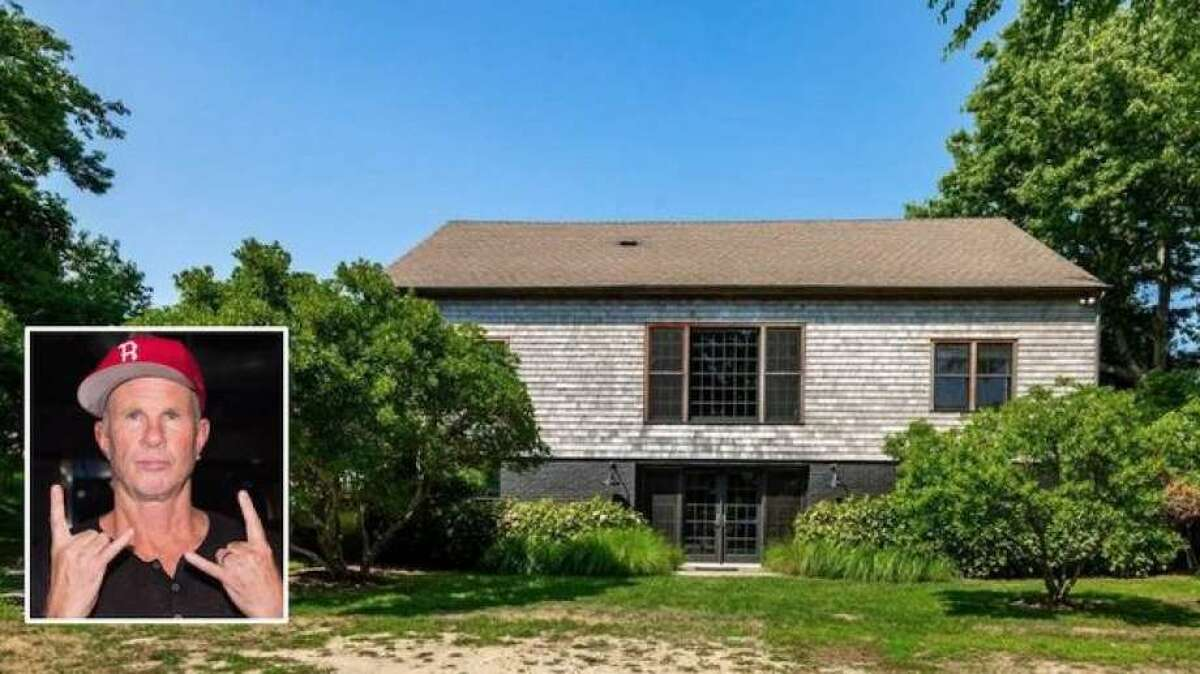 Smith's sumptuous, gated property spans 4 acres and two lots overlooking Fort Pond Bay. Perched on a bluff, it offers amazing views, and the listing details claim that the spread is