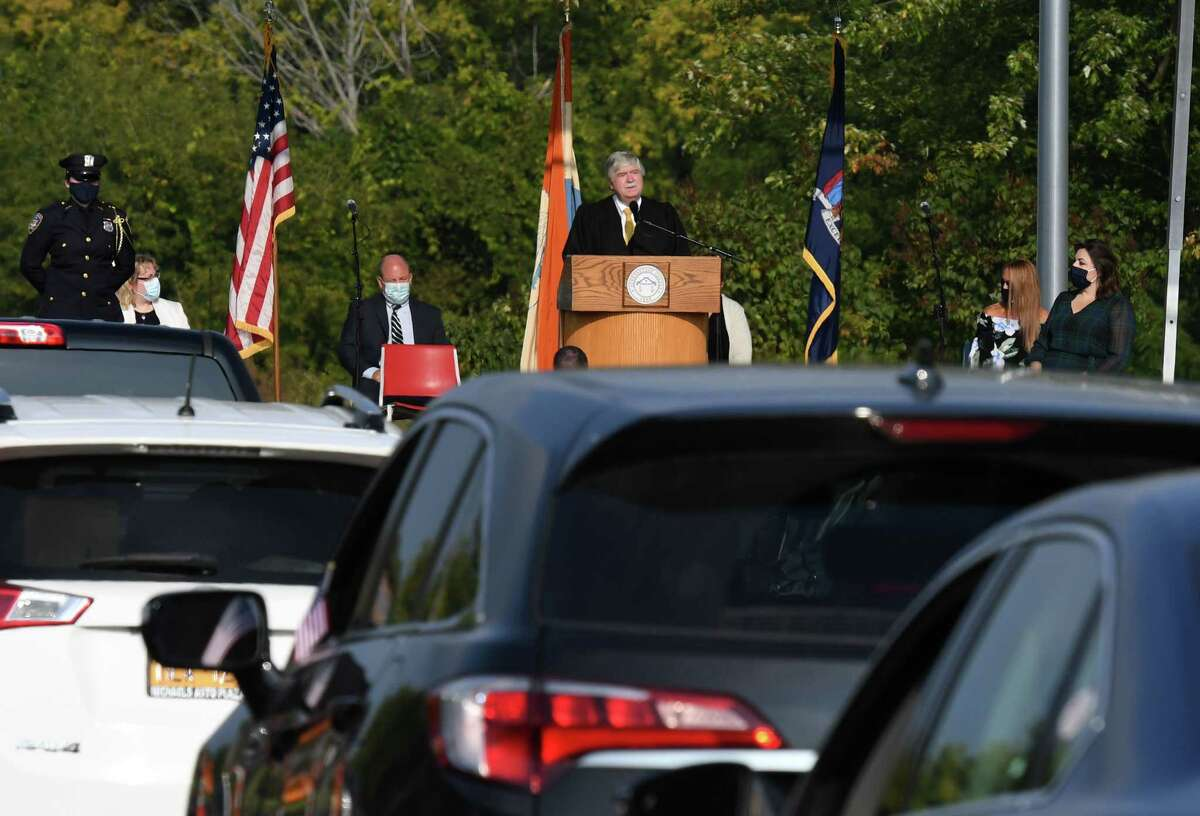 Honorable Judge Mark L. Powers presides over a drive-in naturalization ceremony for 43 new U.S. citizens on Friday, Sept. 25, 2020, during a ceremony held in the Schenectady County Community College parking lot in Schenectady, N.Y. The ceremony was the first of its kind in New York State. (Will Waldron/Times Union)
