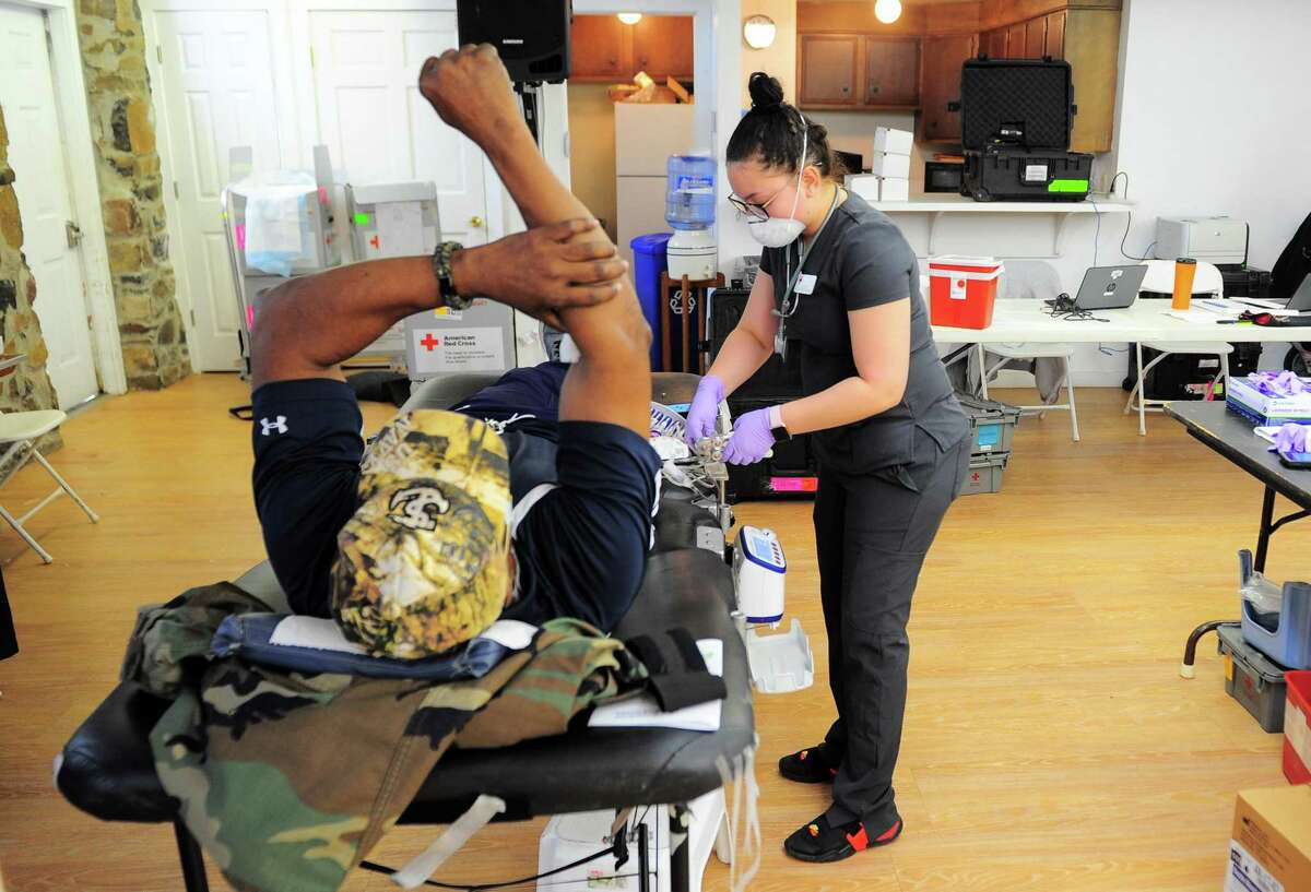 Collection Technician Jayla Ramos prepares donated blood during a American Red Cross blood drive at Whitneyville Cultural Commons in Hamden, in April. The Red Cross is looking for volunteers to deploy to areas of the United States to assist residents.