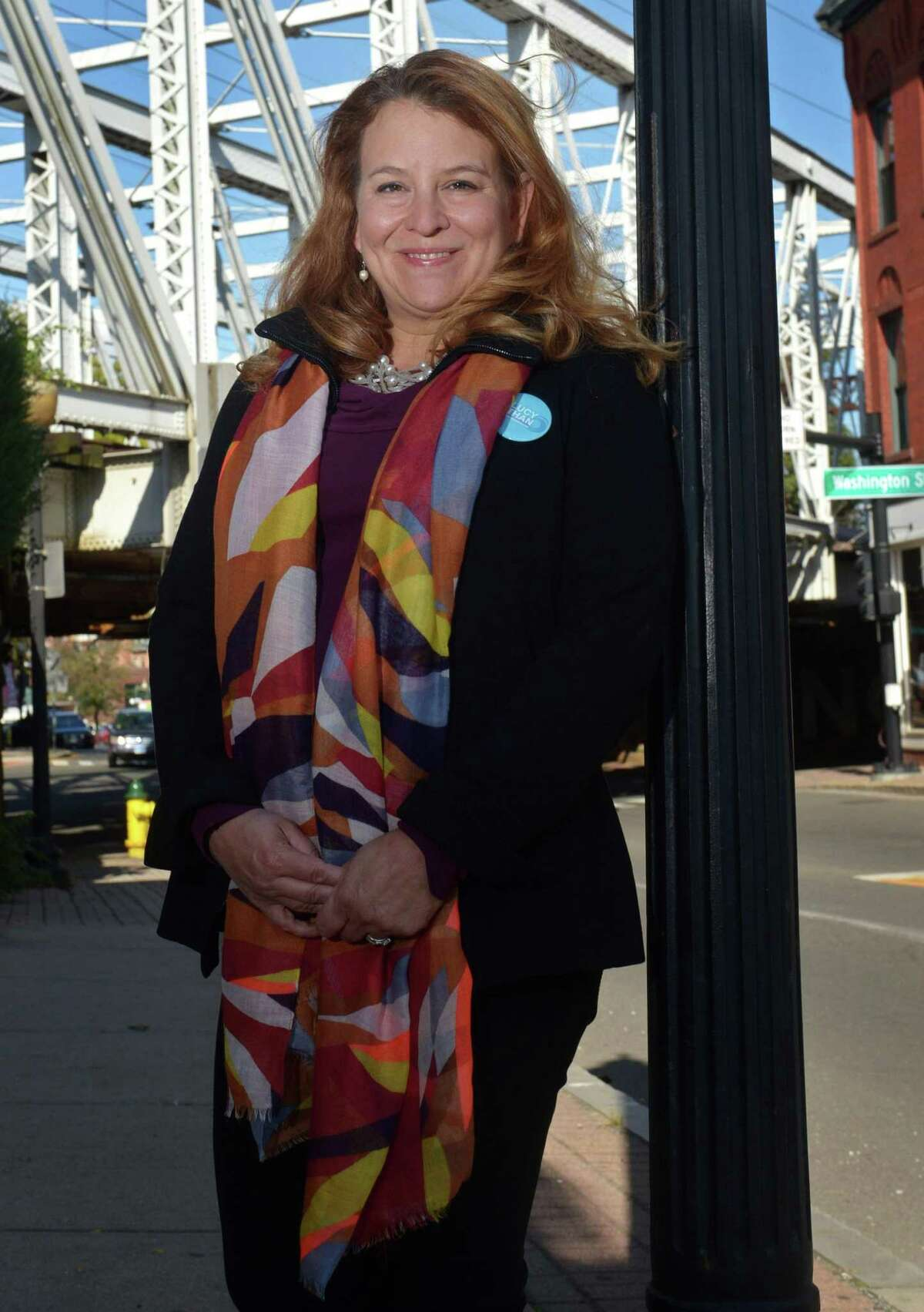 Democrat Lucy Dathan of New Canaan near the Democratic headquarters Wednesday, October 17, 2018, in South Norwalk, Conn. Dathan is banking on her quarter century in the corporate work, will convince voters to elect her to represent the 142nd District in the Connecticut House of Representatives. The district covers West Norwalk and part of New Canaan.