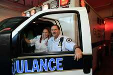 Paramedic Walter Hughes, right, and his daughter EMT Kristina Hughes at Greenwich GEMS station 3 Wednesday, August 19, 2020, in Greewich, Conn. Walter, a long-term employee of the Greenwich Emergency Medical Services, and his daughter, a recent addition to the team, collaborated on a resuscitation to safe a life last month.