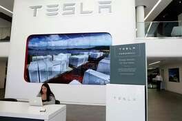 A Powerwall backup battery for the home is displayed at the Tesla store in San Francisco, Calif. on Thursday, June 28, 2018.