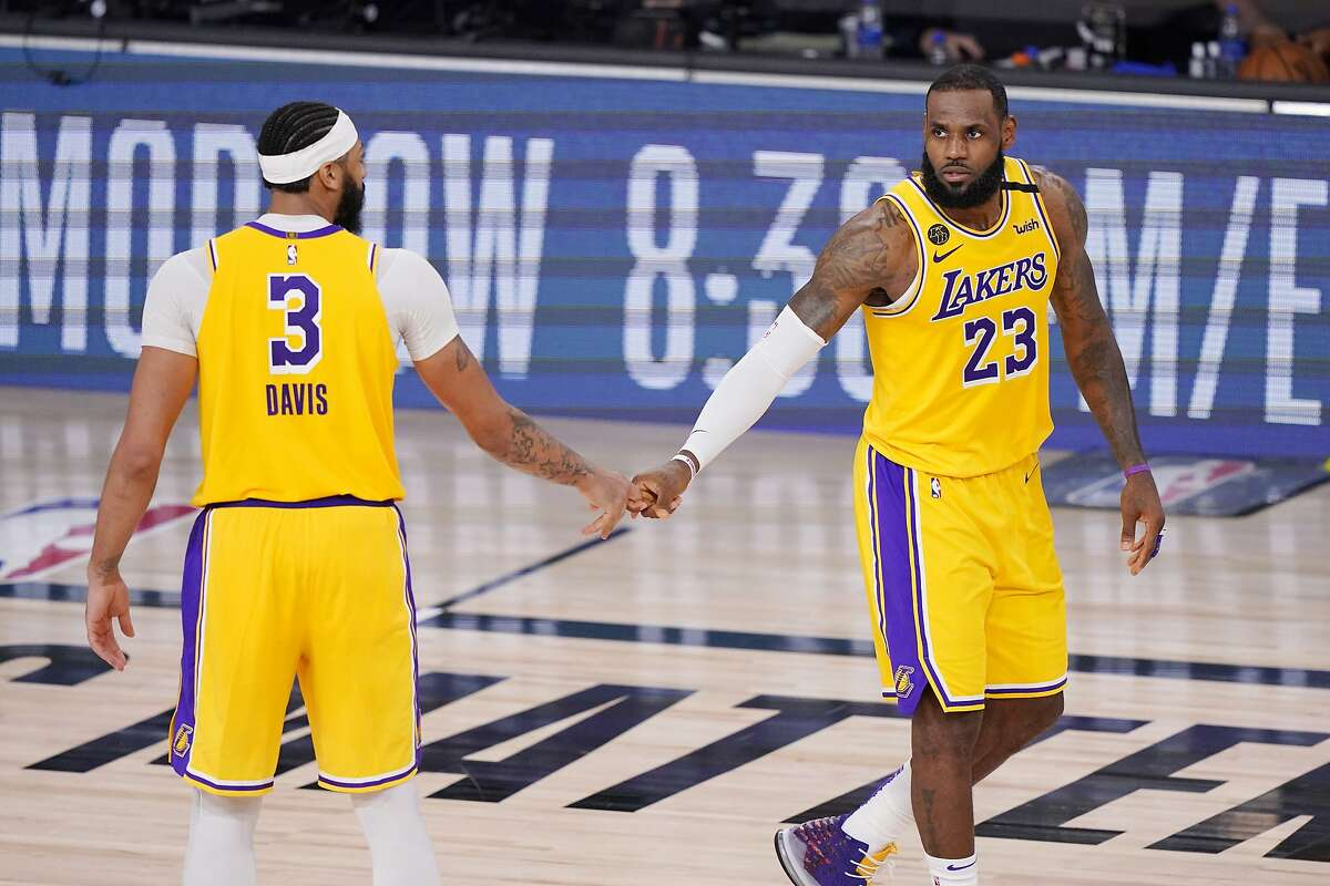 Anthony Davis, LeBron James (23) and the Lakers will try to finish off the Nuggets in the Western Conference Finals on Saturday (6 p.m. TNT).