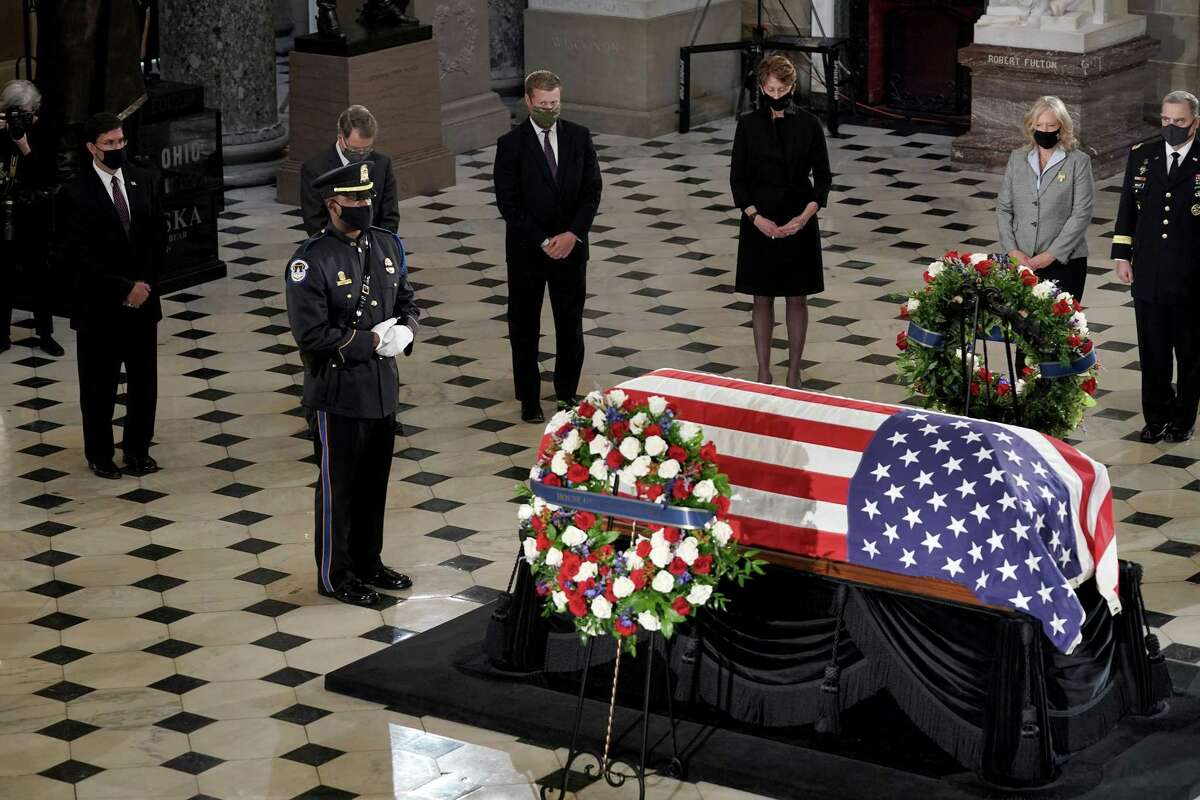 Department of Defense officials pay respects as Justice Ruth Bader Ginsburg lies in state Friday in the U.S. Capitol.