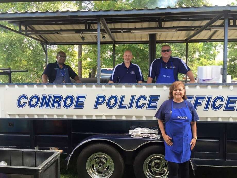 Conroe Police Department year after year brought their barbecue pit out to cook barbecue and hot dogs for the kids and adults that attended Kid Fish and Kid's Day at the Park. Photo: Courtesy Photo