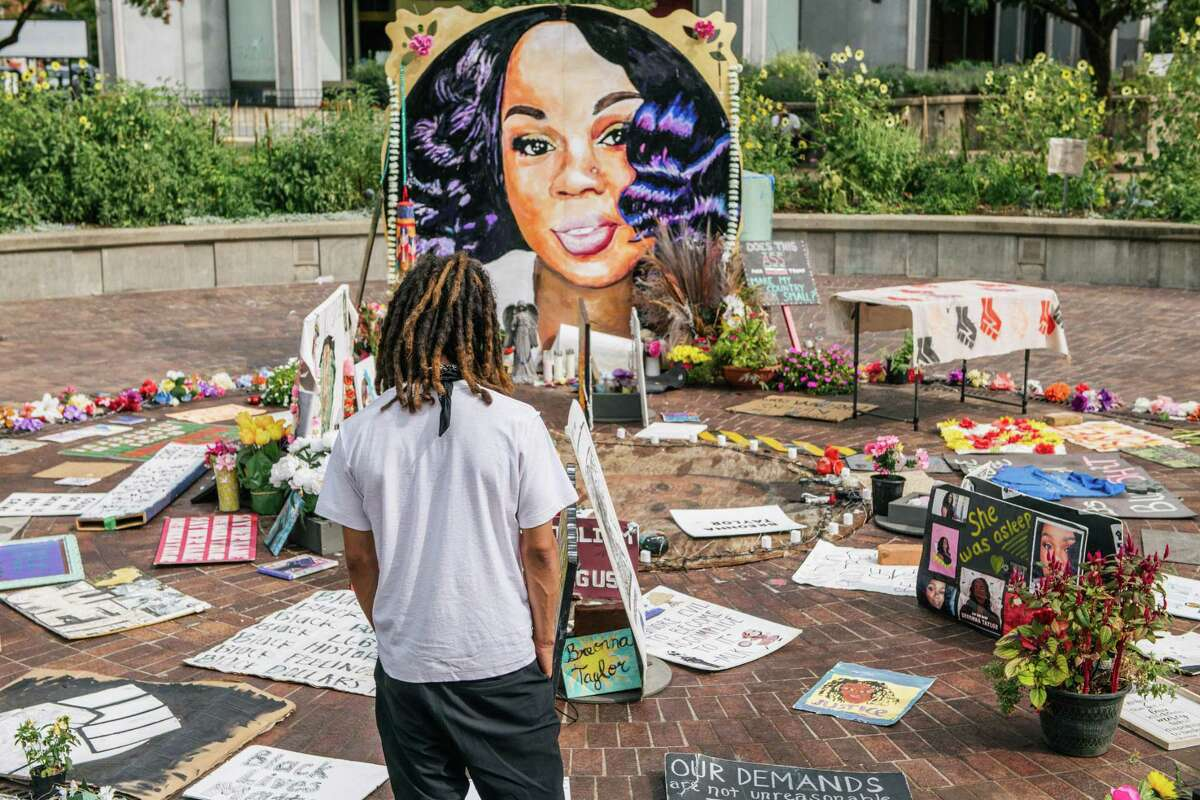 A man looks over a memorial dedicated to Breonna Taylor on Sept. 15 in Louisville, Ky. Breonna Taylor is everywhere - except in the indictment charges brought by the grand jury considering her death.