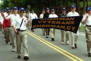 Sherman veterans march in the 2003 Sherman Memorial Day parade.