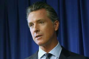 FILE - In this Sept. 18, 2019, file photo, Gov. Gavin Newsom speaks at a news conference in Sacramento, Calif. Newsom signed sweeping labor legislation that aims to give wage and benefit protections to rideshare drivers at companies like Uber and Lyft and to workers across other industries. California is exempting about two-dozen more professions from a landmark labor law designed to treat more people like employees instead of contractors. Gov. Newsom on Friday, Sept. 4, 2020, signed a bill ending what lawmakers said were unworkable limits on services provided by freelance writers and still photographers, photojournalists, and freelance editors and newspaper cartoonists. It also exempts various artists and musicians, along with some involved in the insurance and real estate industries. The law that took effect this year was primarily aimed at ride-hailing giants Uber and Lyft, which are fighting it in court and in a November ballot measure. (AP Photo/Rich Pedroncelli, File)