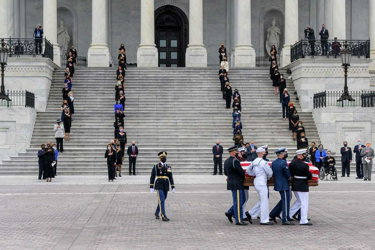 The casket of Supreme Court Justice Ruth Bader Ginsburg is carried out of the U.S. Capitol on Friday.
