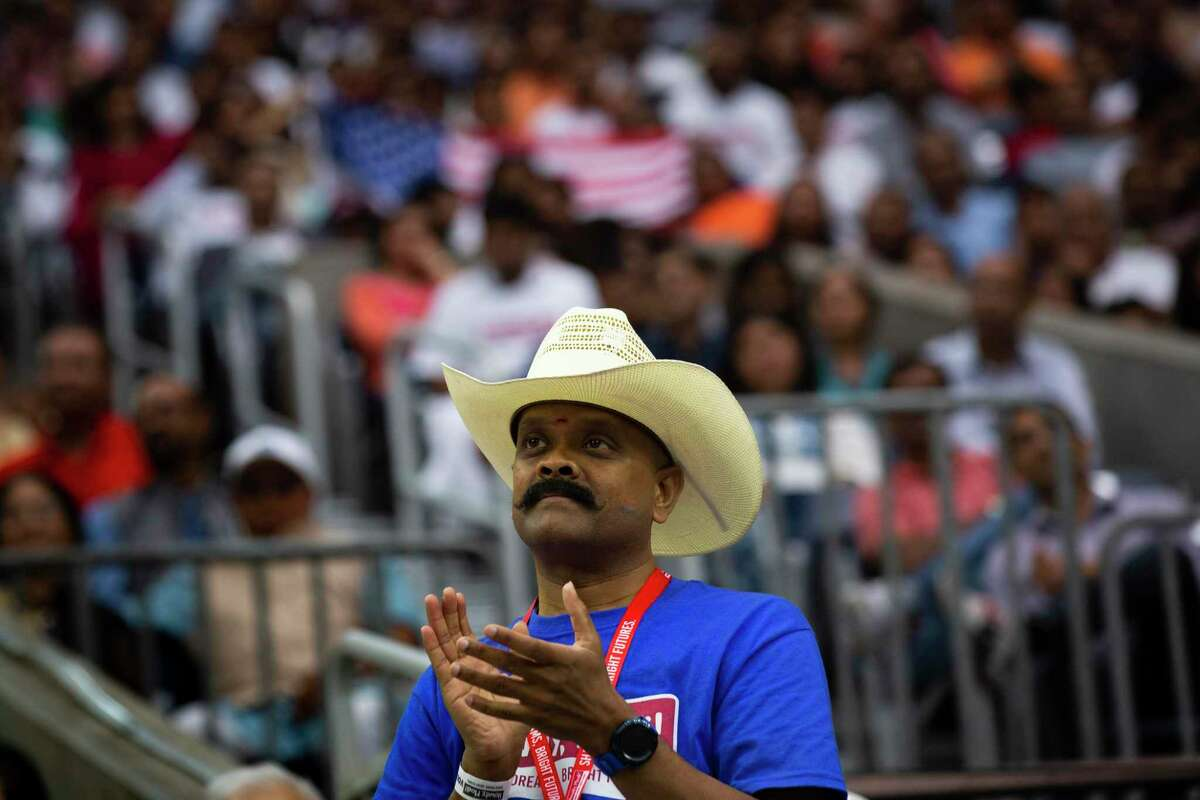 """A supporter of India Prime Minister Narendra Modi applauds during the """"Howdy Modi"""" event last year in Houston."""