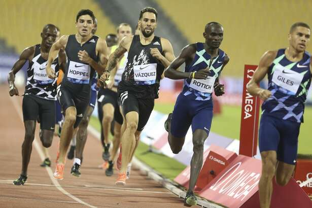 Ferguson Cheruiyot Rotich of Kenya, 2nd right, competes during the Men's 800m at the IAAF Diamond League in Doha, Qatar, Friday, Sept. 25, 2020. Midland High grad Bryce Hoppel is pictured in the black, second from left. (AP Photo/Hussein Sayed)