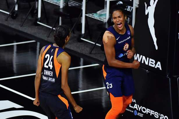 PALMETTO, FLORIDA - SEPTEMBER 24: Alyssa Thomas #25 of the Connecticut Sun celebrates with DeWanna Bonner #24 after converting a steal in the fourth quarter against the Las Vegas Aces during Game Three of their Third Round playoff at Feld Entertainment Center on September 24, 2020 in Palmetto, Florida. NOTE TO USER: User expressly acknowledges and agrees that, by downloading and or using this photograph, User is consenting to the terms and conditions of the Getty Images License Agreement. (Photo by Julio Aguilar/Getty Images)