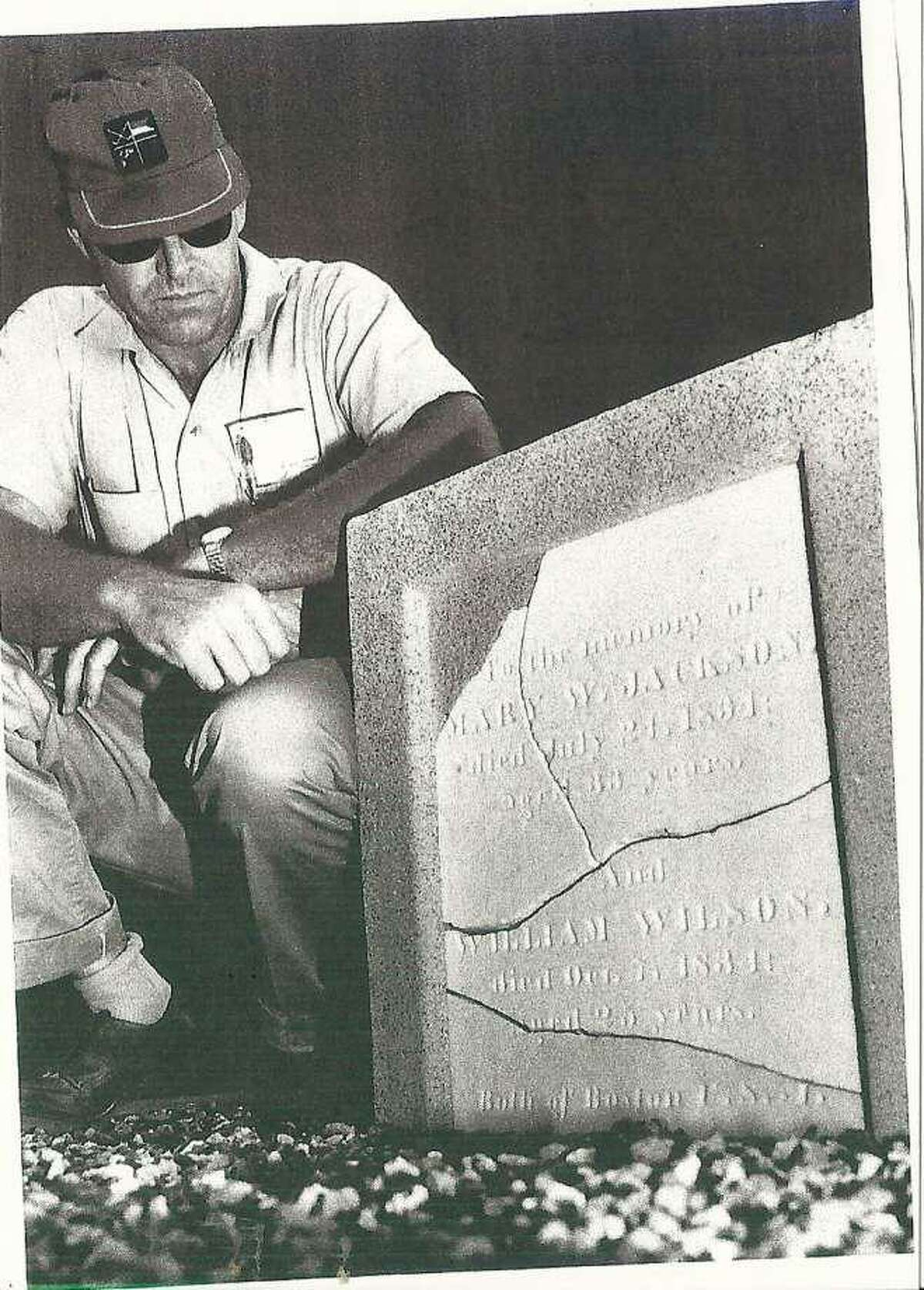 A Shell worker views a tombstone of two early settlers that was found on company property. It is now in Dow Park in Deer Park, where an Oct. 20 ceremony will dedicate a Texas Historical Marker for the headstone.