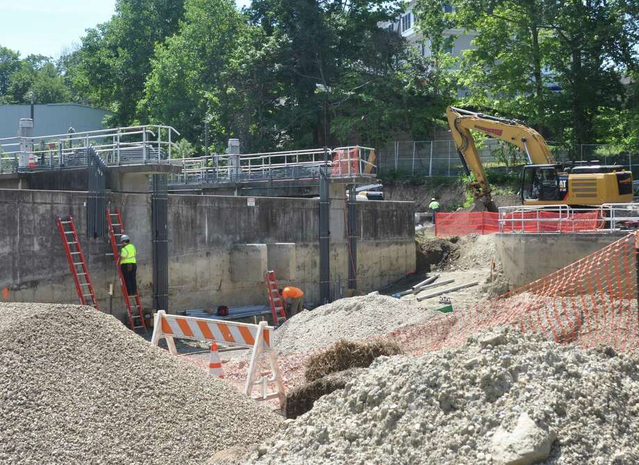 Work at the South Street sewer plant renovation project has mostly continued this summer, with one week in late August lost after a worker tested positive for COVID-19. Photo: Macklin Reid / Hearst Connectcut Media