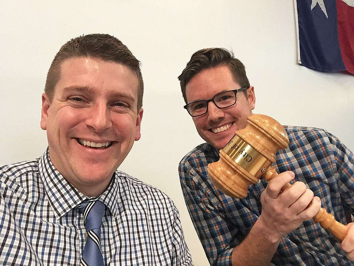 Mayor Andrew Mitcham, holding gavel, and City Manager Austin Bleess work together to guide the city through the coronavirus pandemic.
