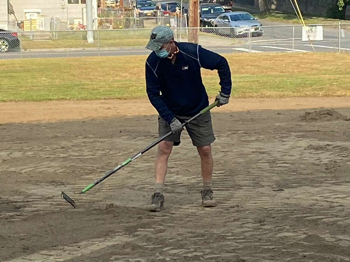 """ValleyCats president Rick Murphy works on a Watervliet softball field Friday as part of the """"4 in 24"""" project the team is completing to help area organizations upgrade their facilities. Murphy hopes to hear something tangible about Tri-City's future by Wednesday. (Mark Singelais / Times Union)"""