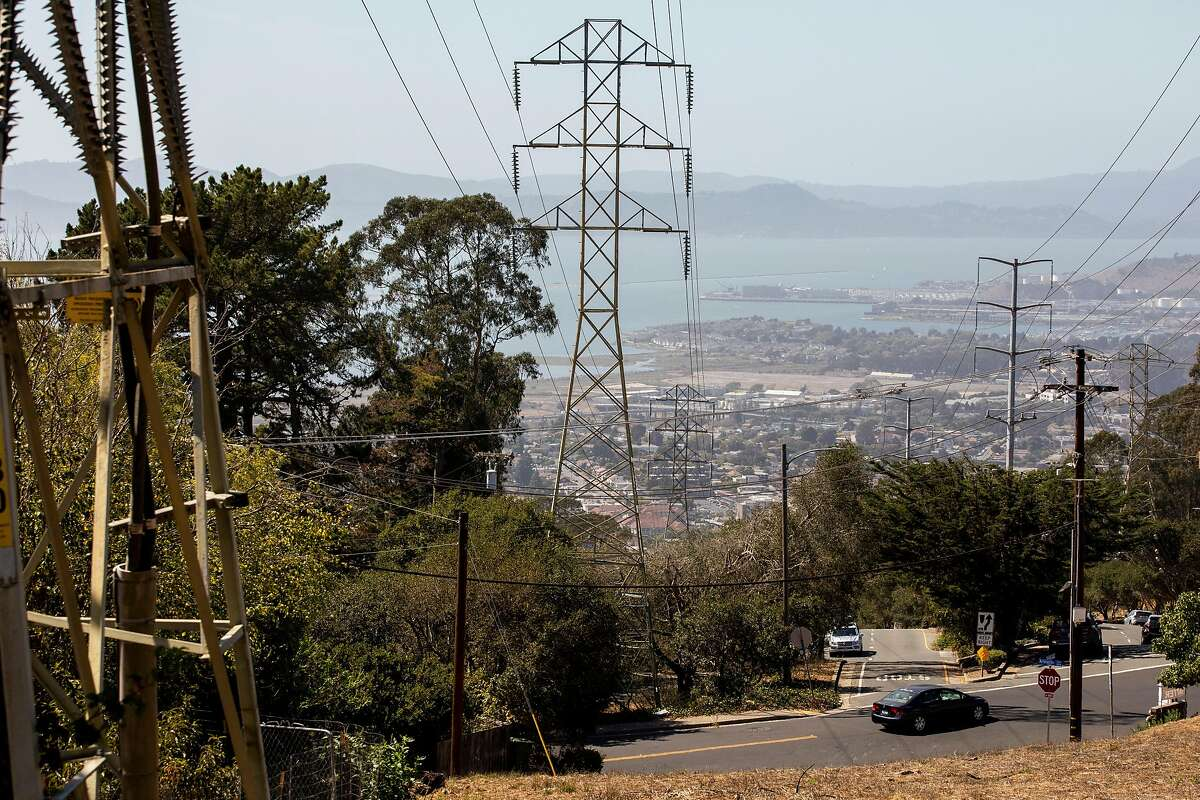 High-voltage power lines over homes and dry grass on Terrace Drive in El Cerrito pose a danger during wildfire season.