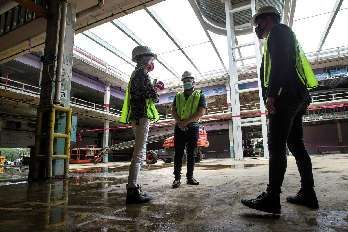 Judy Nyquist, left, and Derrick Diotalei, and Kirby Liu, of Lovett Commercial, tour POST Houston, the downtown redevelopment of the former Barbara Jordan Post office Thursday, Sept. 24, 2020 in Houston. The historic former Barbara Jordan Post Office is being redeveloped to include a six-acre rooftop farm and park with panoramic skyline views of Houston. Lovett Commercial is developing the space, calling it POST Houston with plans to include experimental shopping options, an international food hall, co-working offices, and a music venue.