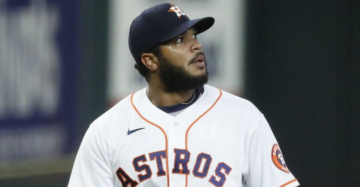 Houston Astros relief pitcher Josh James (39) reacts after Texas Rangers Eli White's RBI single during the seventh inning of an MLB baseball game at Minute Maid Park, Thursday, September 17, 2020, in Houston.