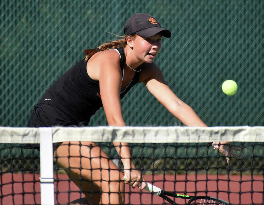Edwardsville's Morgan Marshall races to the net to play a shot during her No. 6 singles match against Jersey on Friday. Photo: Matt Kamp|The Intelligencer
