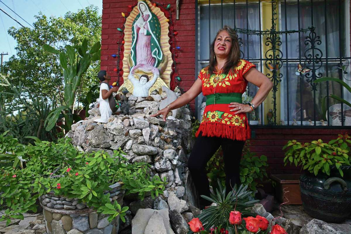 Dali Torres stands by her shrine dedicated to the Virgen de Guadalupe in front of her house.
