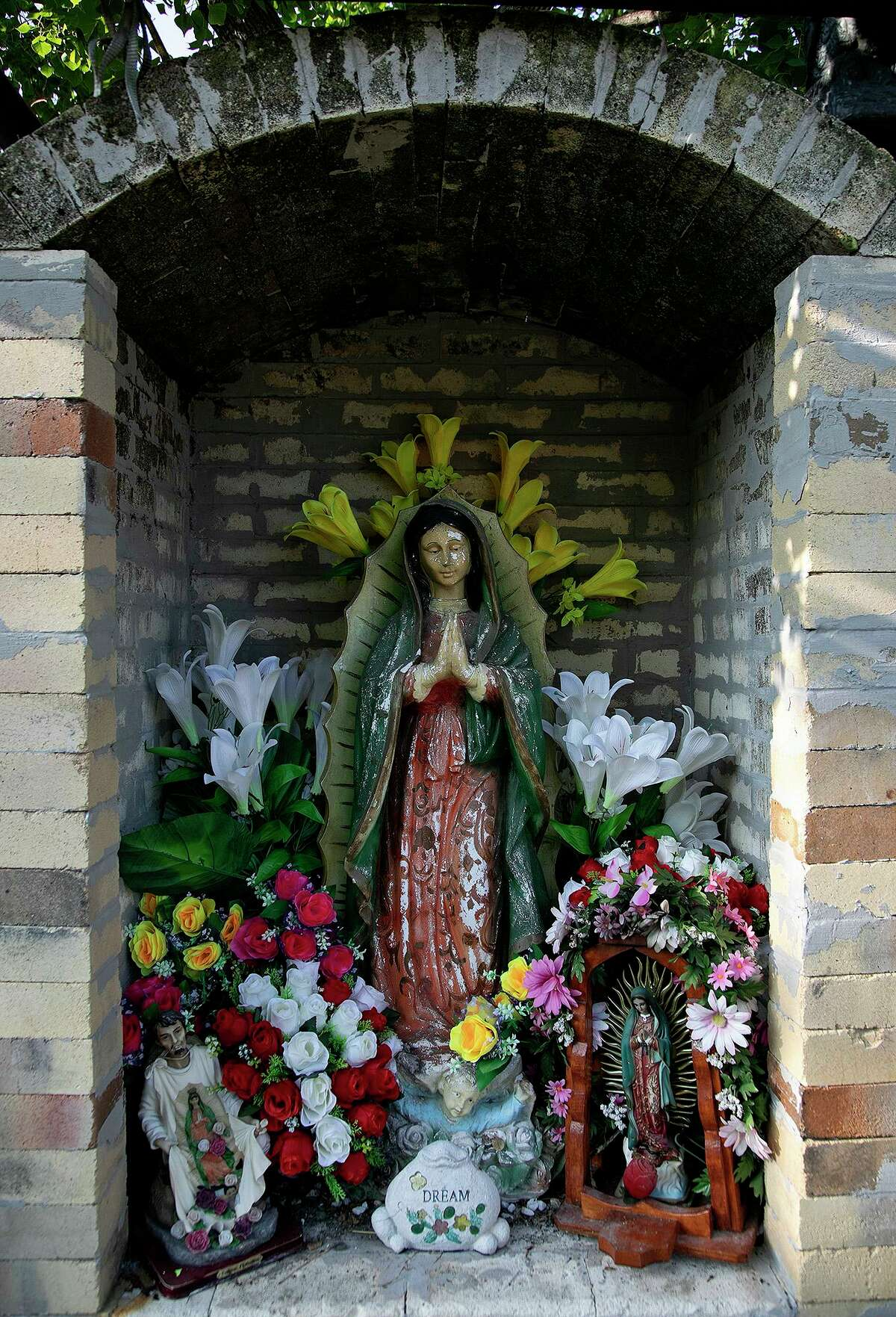 Vanessa Martinez's Virgen de Guadalupe yard shrine at her home in San Antonio is made from an old furnace.