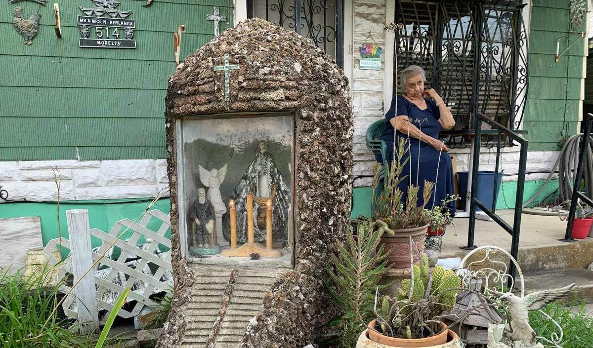 Andrea Gomez sits outside her San Antonio home, which has a yard shrine dedicated to La Virgen de San Juan de Los Lagos. The shrine dates back around 60 years.