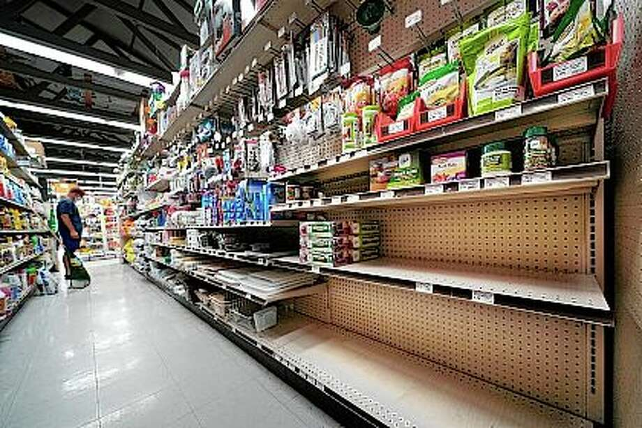Shelves that usually are stocked with canning supplies are mostly empty earlier this month. During this ongoing coronavirus pandemic, many retailers have been frustrated by the scarce supply of jars and lids used for canning vegetables. Photo: Robert F. Bukaty | AP / Copyright 2020 The Associated Press. All rights reserved.