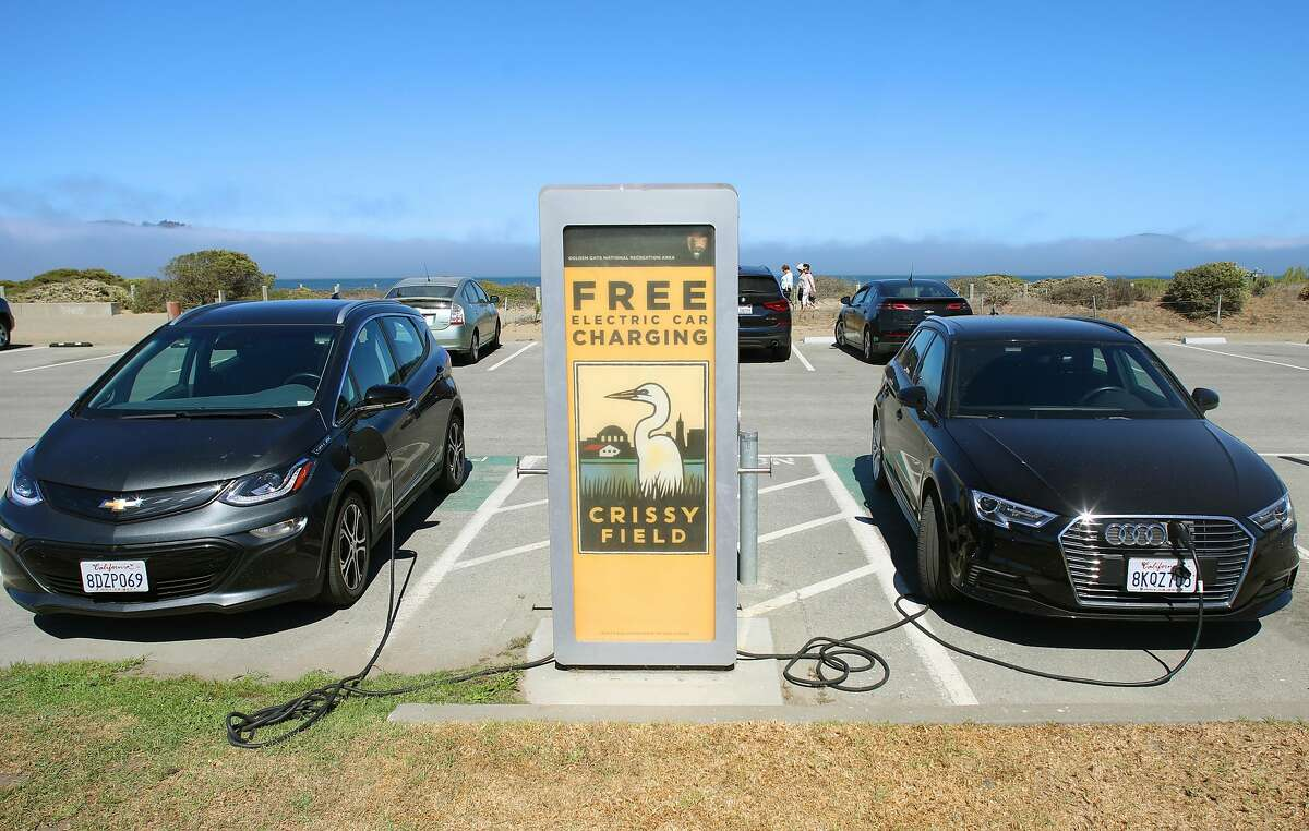 A free electric car charging station being used seen in front of the Crissy Field Center on Thursday, Sept. 24, 2020, in San Francisco, Calif.