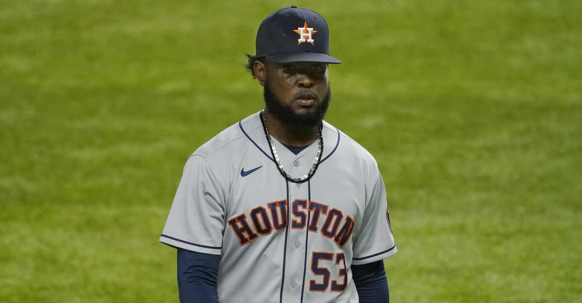 Houston Astros pitcher Cristian Javier walks off the field after being replaced during the sixth inning of the team's baseball game against the Texas Rangers in Arlington, Texas, Thursday, Sept. 24, 2020. (AP Photo/Tony Gutierrez)