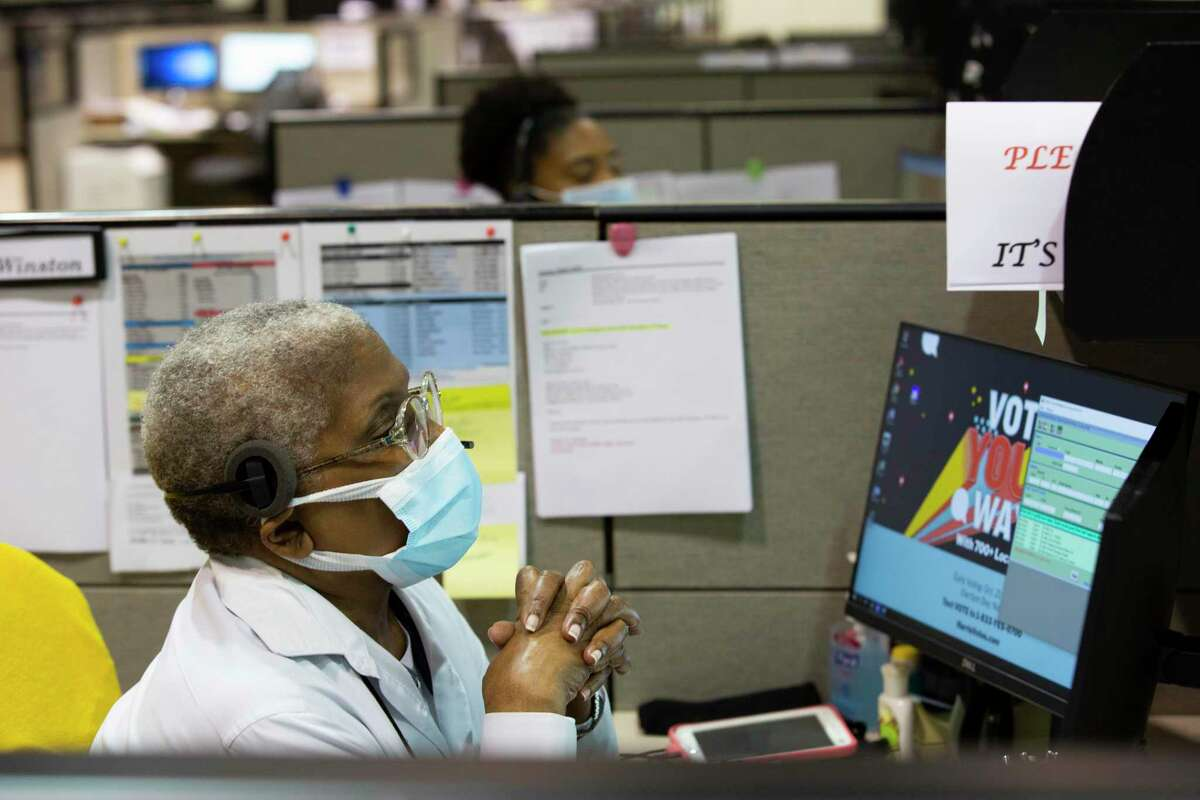 A Harris County voter information call center worker at the Harris County elections headquarters, Friday, Sept. 25, 2020, in Houston.