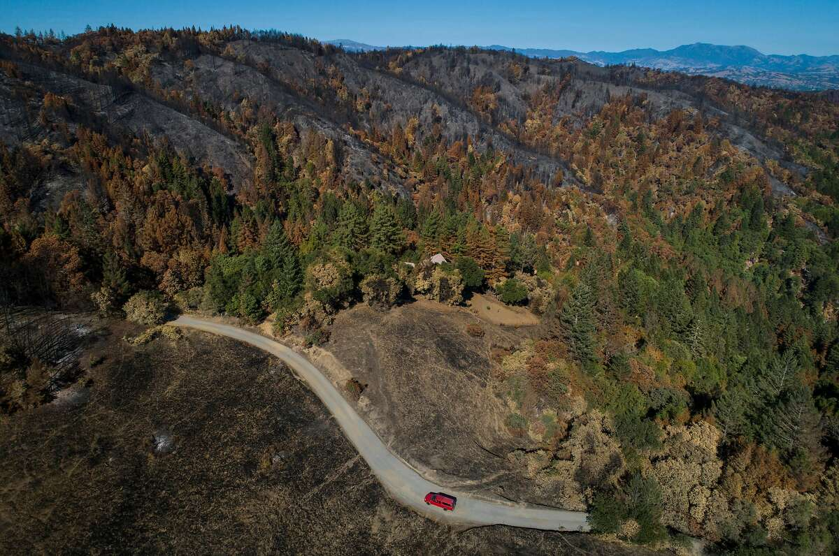 A truck makes its way up a private road off Sweetwater Springs Road in the areas devastated by the Walbridge fire outside Healdsburg, Calif., on Wednesday, September 23, 2020.