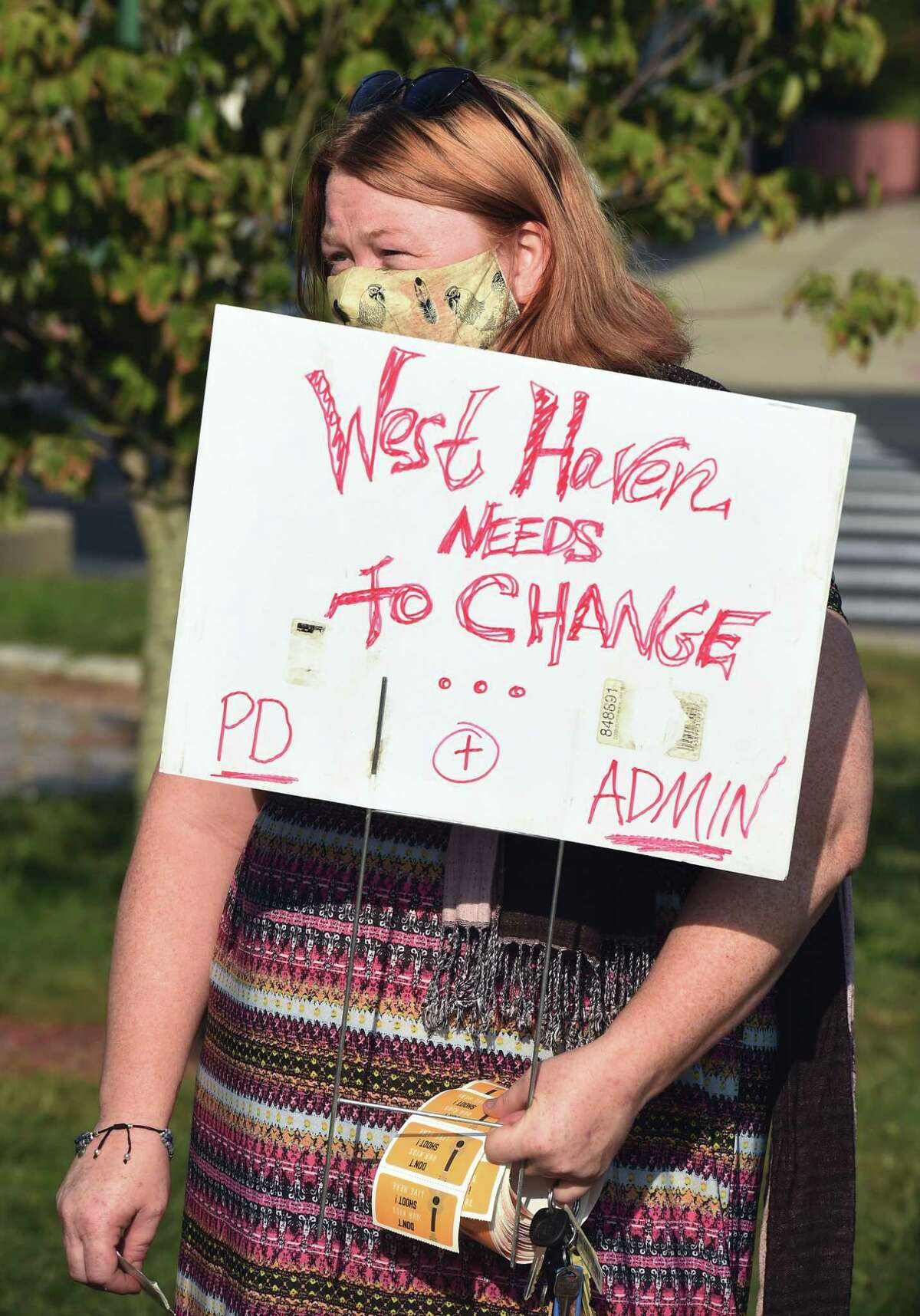 Elinor Slomba of West Haven listens to speakers at a press conference condemning recent actions by the West Haven Police Department in front of City Hall in West Haven on September 25, 2020.