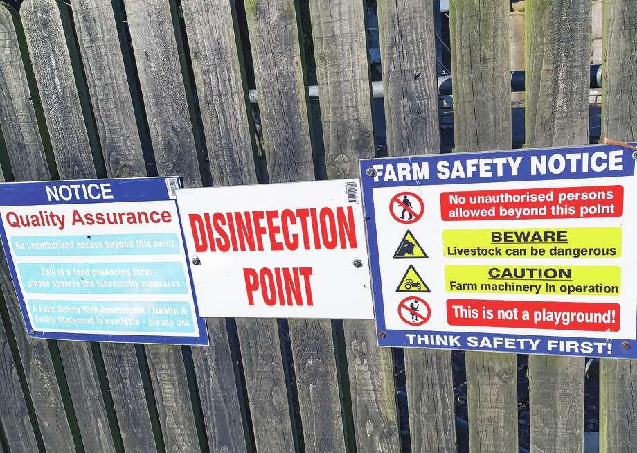 A sign warns about potential dangers on a farm. Photo: Mikroman6 / ©2014-2019 Tomasz Skoczen