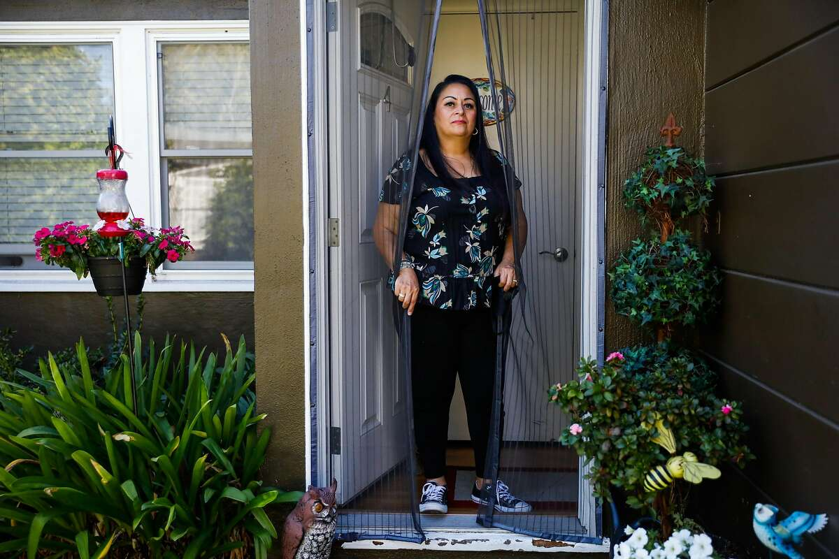 Charlotte Juarez poses for a portrait at her home on Thursday, Sept. 24, 2020 in Burlingame, California. Charlotte was in the hospital with the coronavirus in June and is still experiencing lingering effects including fatigue and heart palpitations.