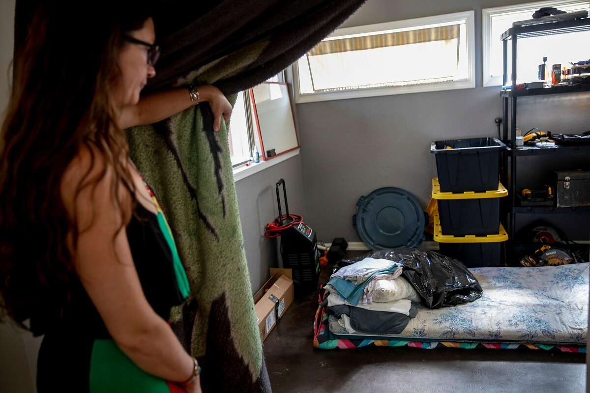 Amy Black shows a room in her Chico apartment that she offered to her former neighbor, who also lost a home.