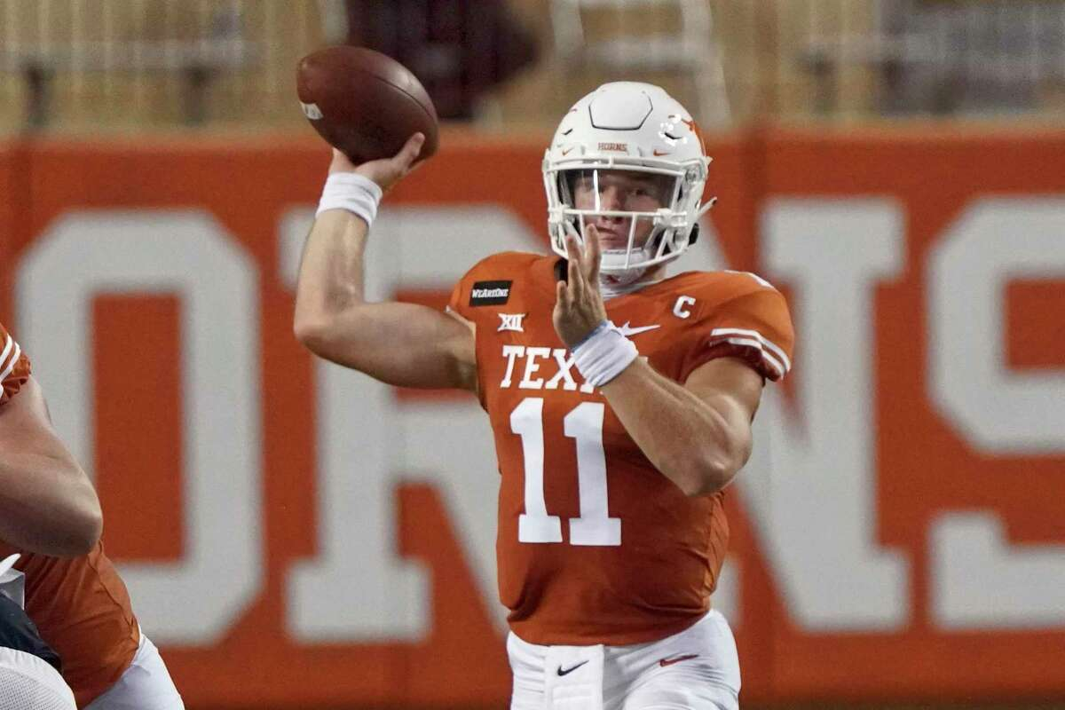 Texas' Sam Ehlinger (11) looks to pass against UTEP during the first half of an NCAA college football game in Austin, Texas, Saturday, Sept. 12, 2020. (AP Photo/Chuck Burton)