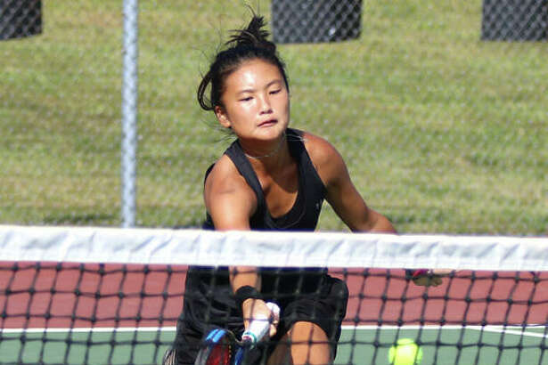 Edwardsville's Chloe Koons extends to return a shot in her No. 1 singles match against Jersey on Friday afternoon in the Southern Illinois Duals girls tennis tournament at the EHS Courts in Edwardsville.