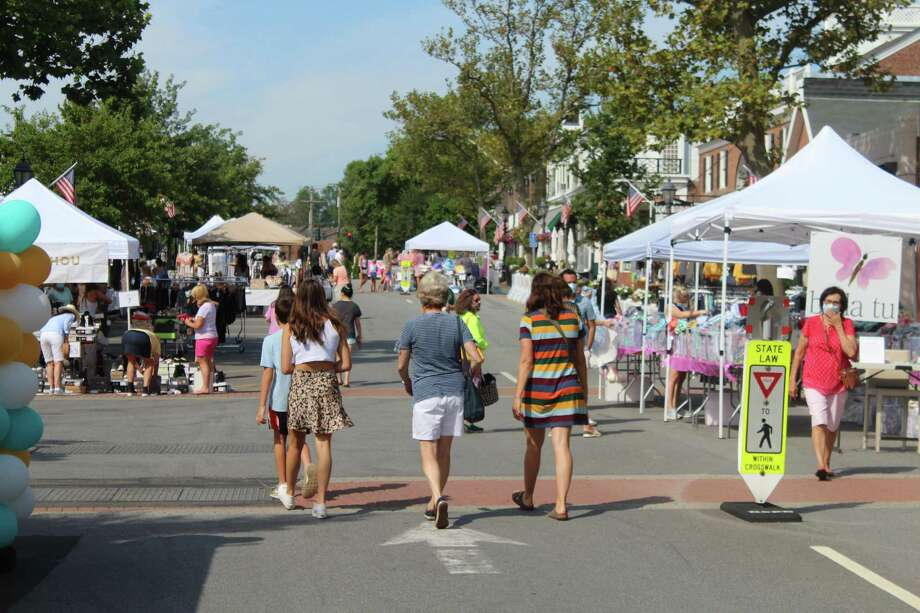 "With Elm Street closed to traffic Saturday, Aug. 22, the second day of the ""So Long to Summer Sale"" in New Canaan offered the feel of a pedestrian mall, and a chance to step out downtown for one of the few times since the Coronavirus pandemic began in March. Photo: John Kovach / Hearst Connecticut Media / New Canaan Advertiser"