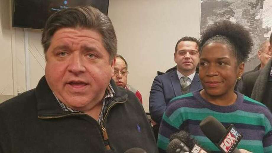 "Gov. J.B. Pritzker, left, is seen with Lt. Gov. Juliana Stratton in a 2018 file photo. Stratton this week said if the graduated income tax amendment fails Nov. 3 state residents could see personal income taxes rise by ""at least 20%."""