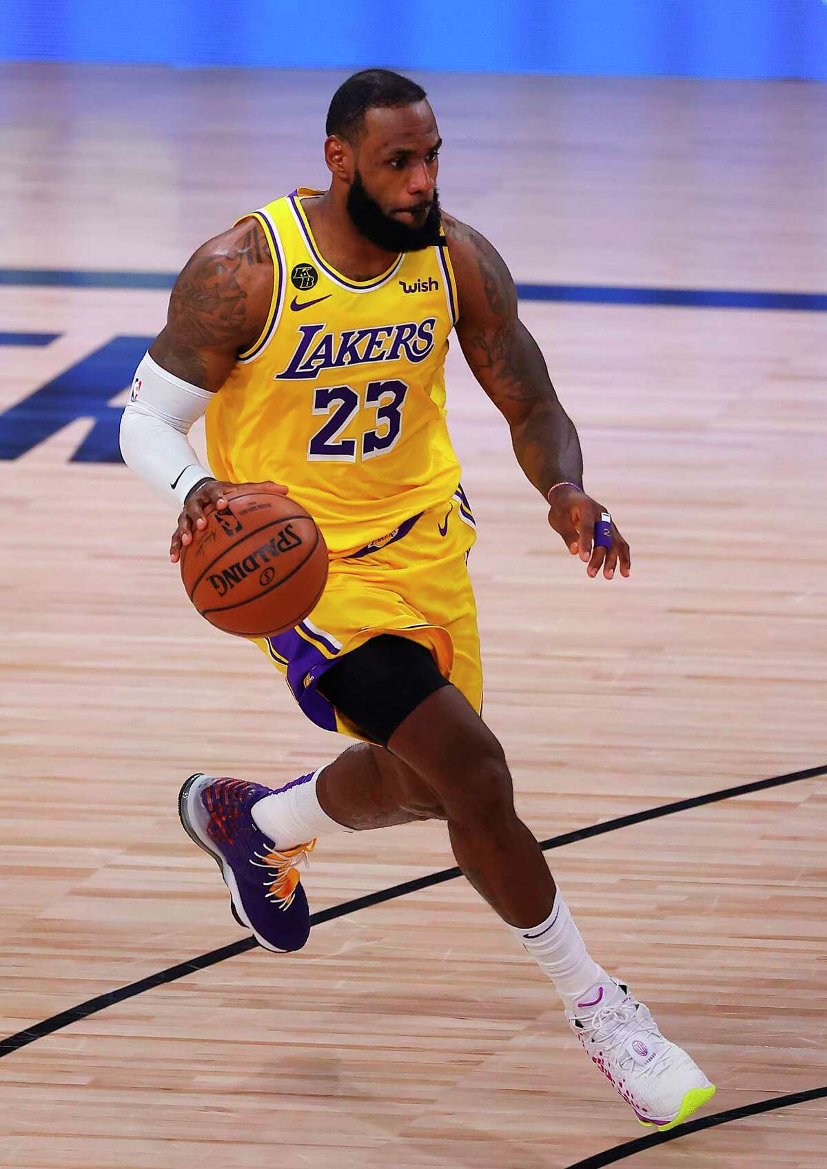LAKE BUENA VISTA, FLORIDA - SEPTEMBER 24: LeBron James #23 of the Los Angeles Lakers dribbles the ball during the second quarter against the Denver Nuggets in Game Four of the Western Conference Finals during the 2020 NBA Playoffs at AdventHealth Arena at the ESPN Wide World Of Sports Complex on September 24, 2020 in Lake Buena Vista, Florida. NOTE TO USER: User expressly acknowledges and agrees that, by downloading and or using this photograph, User is consenting to the terms and conditions of the Getty Images License Agreement. (Photo by Mike Ehrmann/Getty Images)