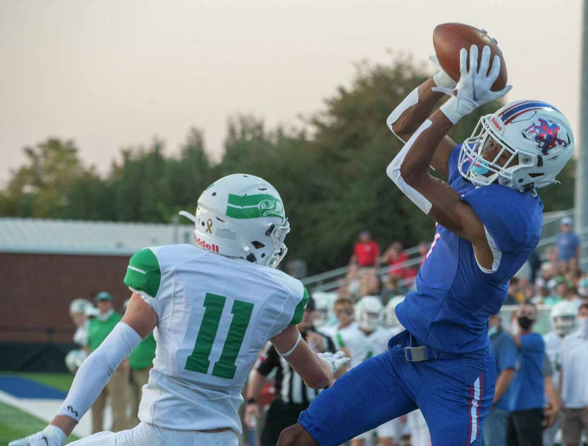 Midland Christian's Christopher Brazzell goes up for a touchdown catch over Wall's Jake Andrews 09/25/2020 at Gordon Awtry Field. Tim Fischer/Reporter-Telegram